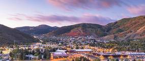 view of park city in valley at sunset