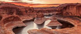 river going through rock formations, sunset